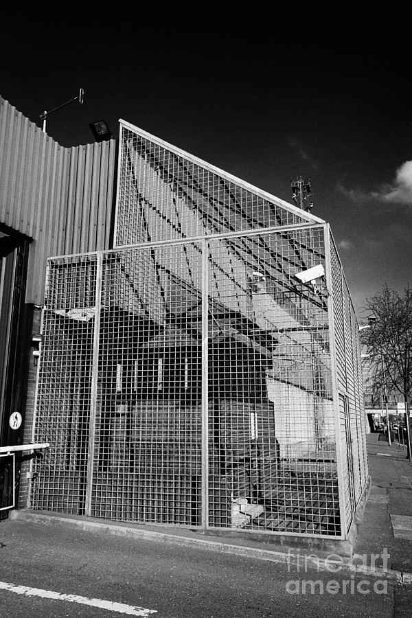 anti rpg cage surrounding observation sanger at North Queen Street PSNI police station Belfast North Photograph