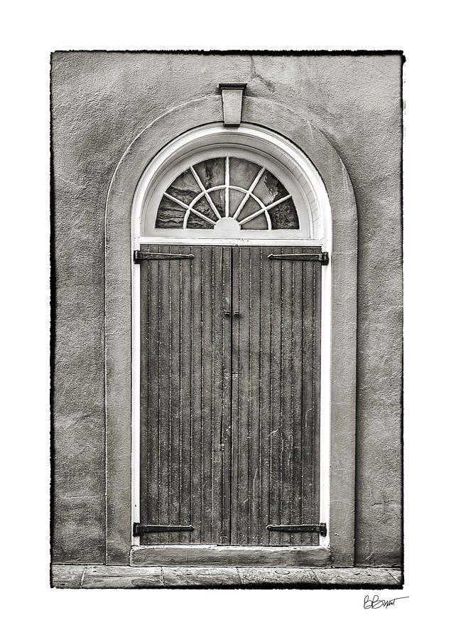 Arched Door In French Quarter In Black And White Photograph