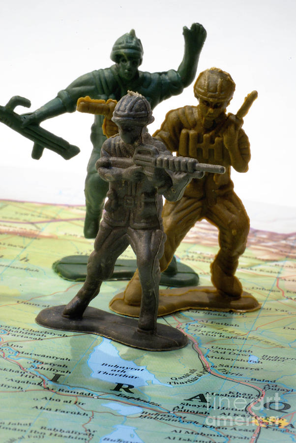 Armed Toy Soliders On Iraq Map Photograph