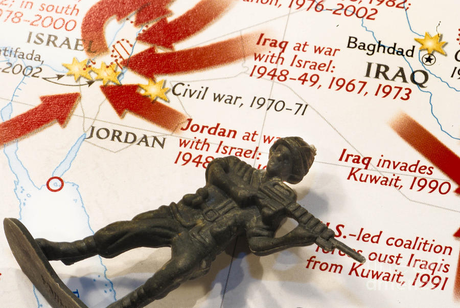 Army Man Lying On Middle East Conflicts Map Photograph