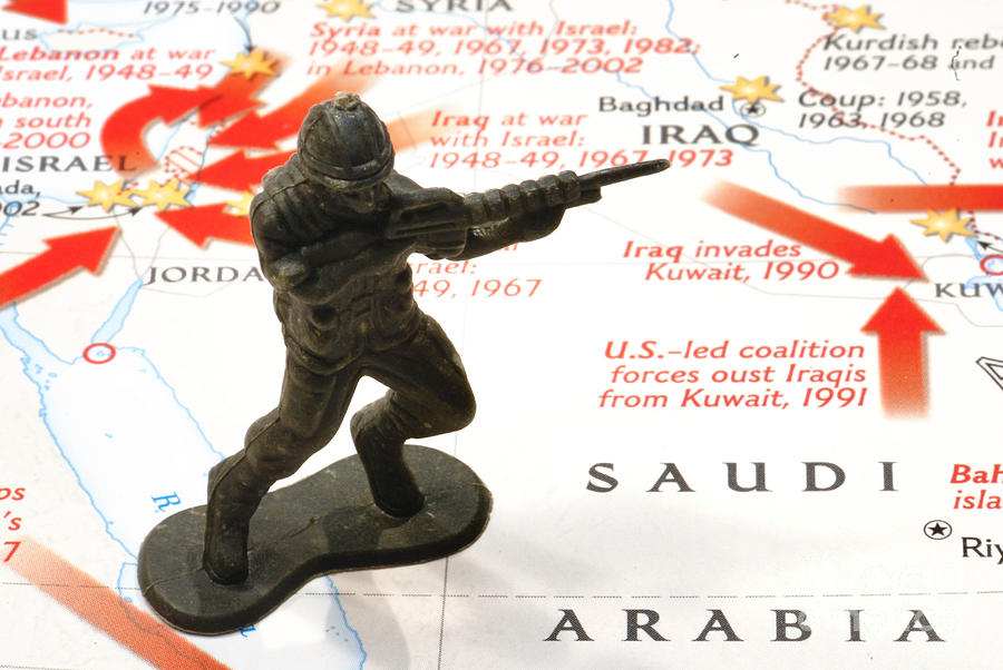 Army Man Standing On Middle East Conflicts Map Photograph