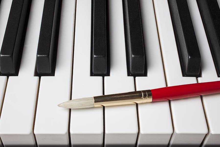 Artist Brush On Piano Keys Photograph