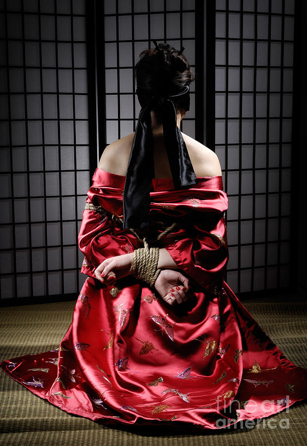 Asian Woman With Her Hands Tied Behind Her Back Photograph