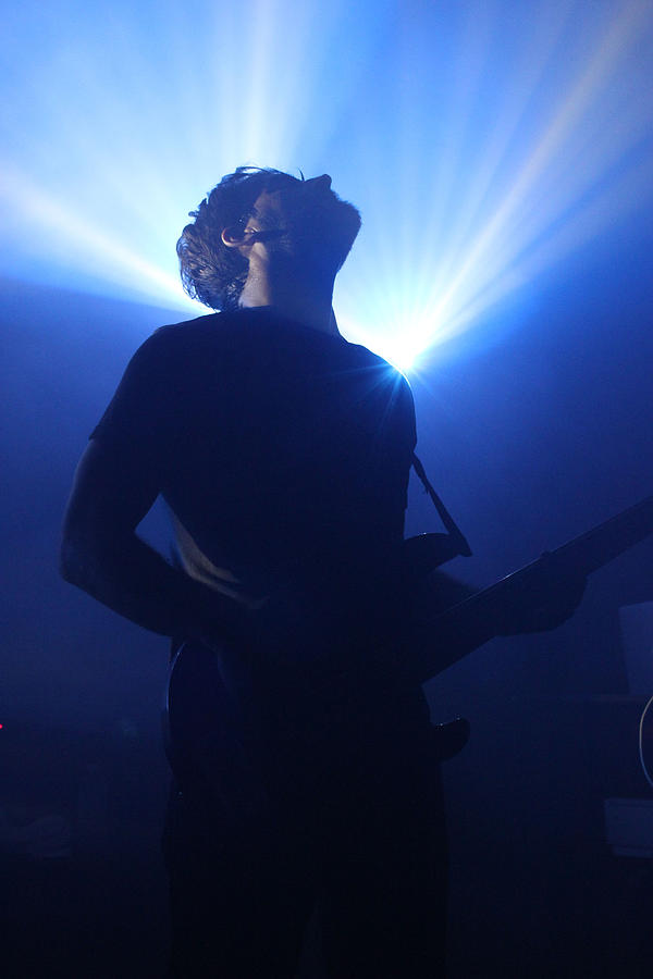 Backlit Bassist Photograph