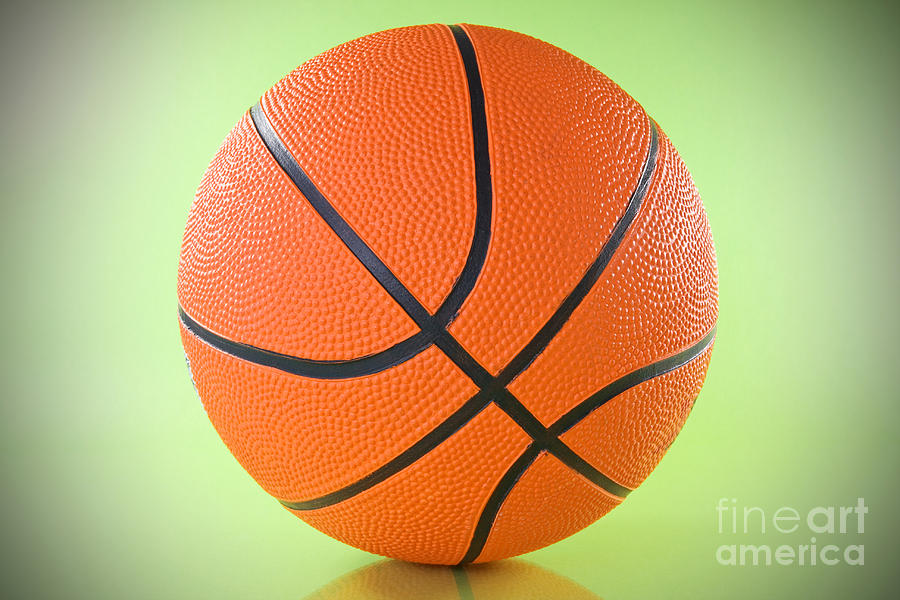 Basketball Ball Over A Green Background Photograph
