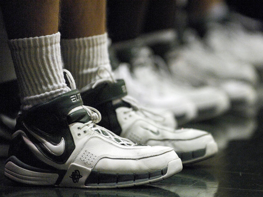 Basketball Shoes In A Row Photograph