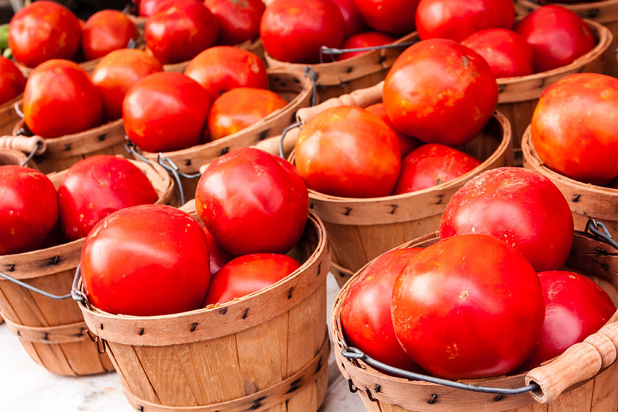 Baskets Of Tomatoes At A Farmers Market Photograph