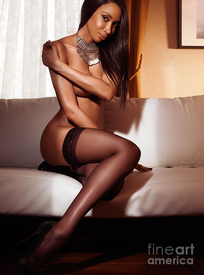 Beautiful Sexy Black Woman In Stockings Sitting On Sofa Photograph
