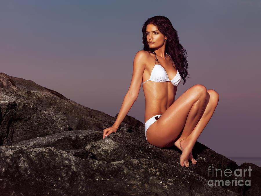 beautiful-woman-wearing-bikini-sitting-o
