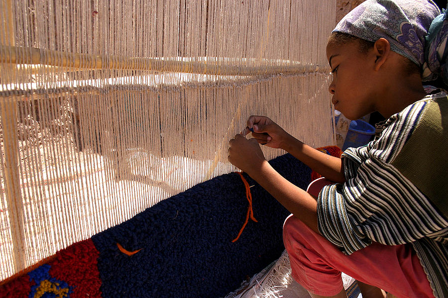 Berber Girl Working On Traditional Berber Rug Ait Benhaddou Southern Morocco Photograph  - Berber Girl Working On Traditional Berber Rug Ait Benhaddou Southern Morocco Fine Art Print