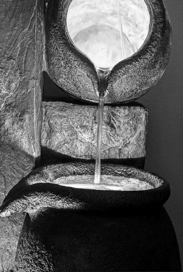 Black and white water pouring forth from large stone pots photograph by valerie garner - Valerie garnering ...