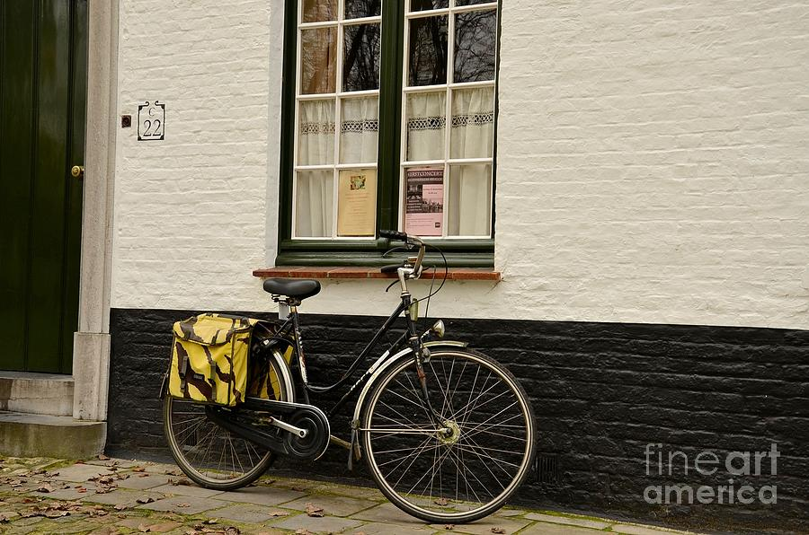Black Cycle Rests On Window Sill Photograph  - Black Cycle Rests On Window Sill Fine Art Print