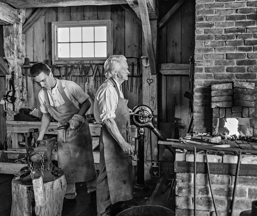 Blacksmith And Apprentice 2 Bw Photograph