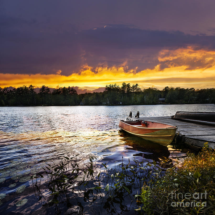 Boat On Lake At Sunset Photograph