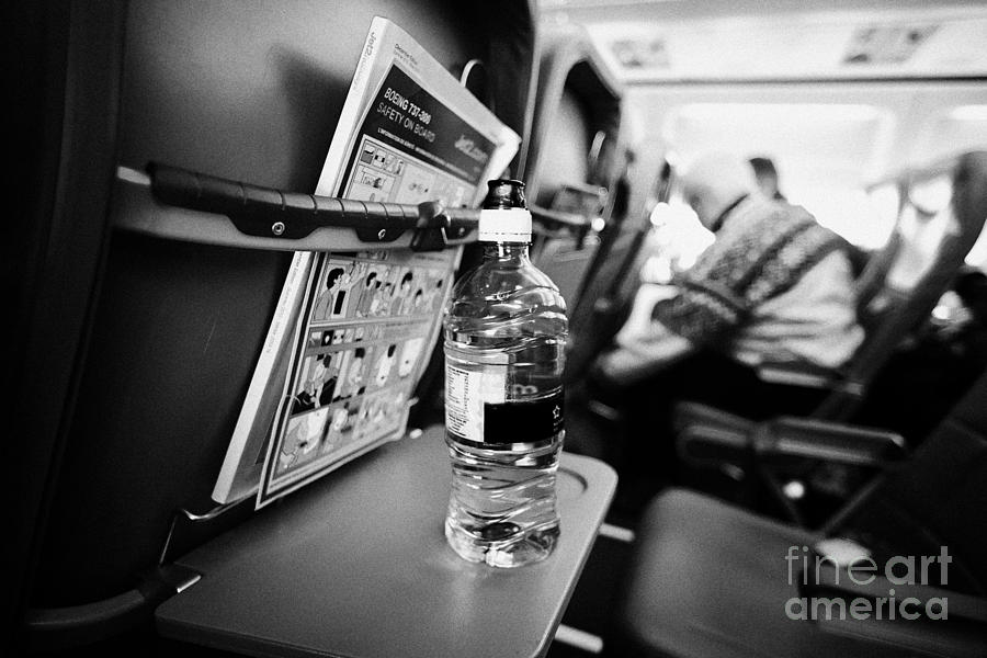 Bottle Of Water On Tray Table Interior Of Jet2 Aircraft Passenger Cabin In Flight Europe Photograph