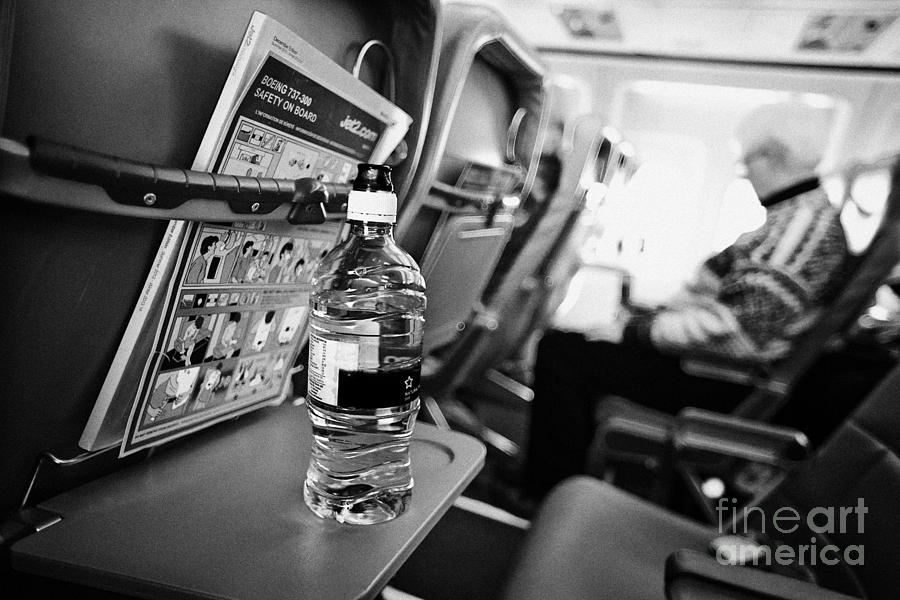 Bottle Of Water On Tray Table Interior Of Jet2 Aircraft Passenger Cabin In Flight Photograph