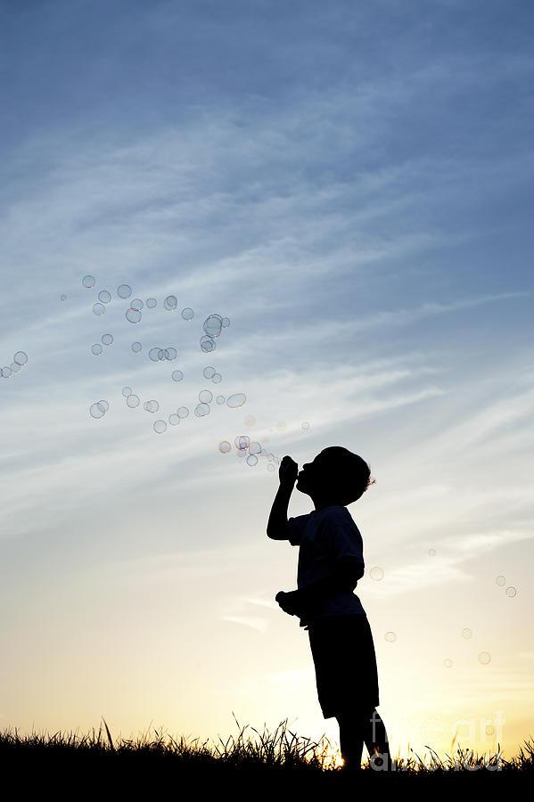Boy Blowing Bubbles Photograph