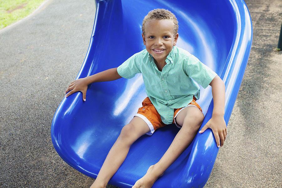 Boy On Slide Photograph
