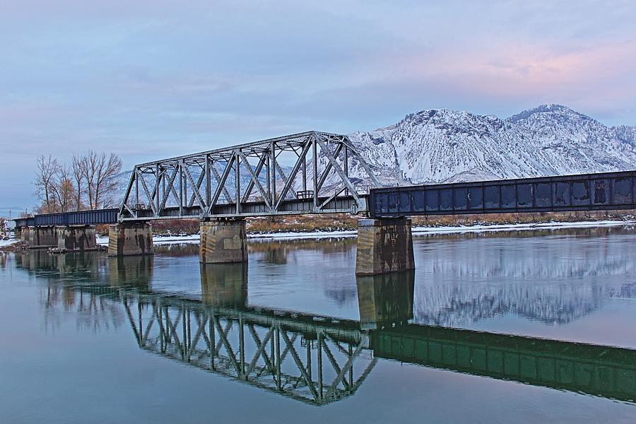 Landscape Photograph - Bridge Over Tranquil Waters In Kamloops British Columbia by Steve Boyko