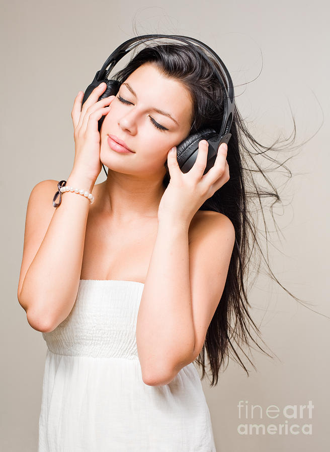 Brunette Immersed In Music Wearing Headphones. Photograph