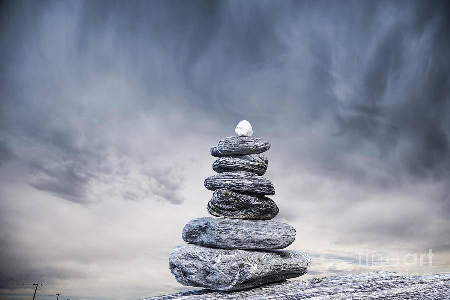 Cairn And Stormy Sky Photograph