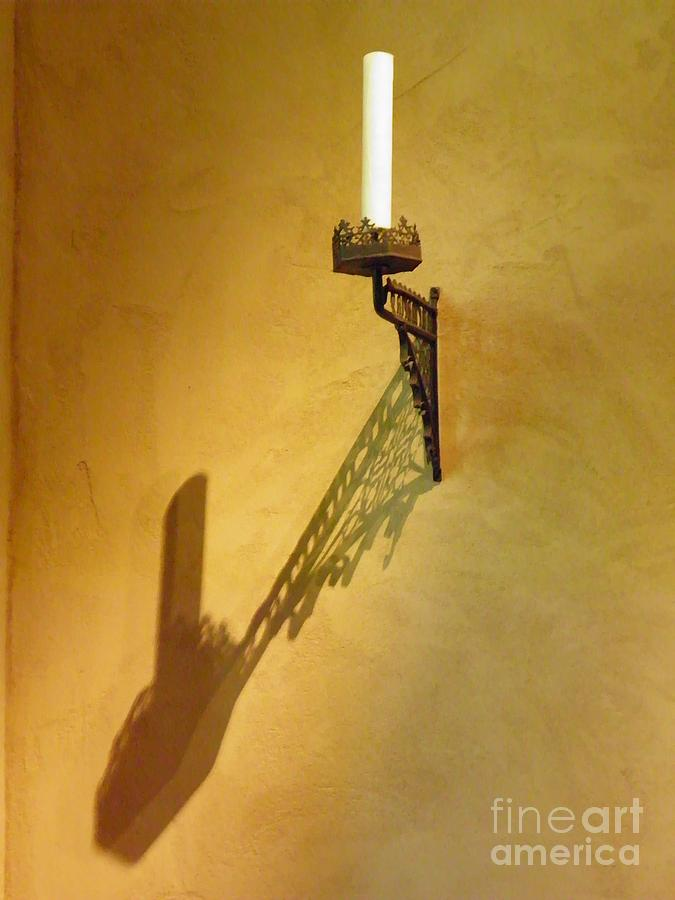 Candle On The Wall Photograph