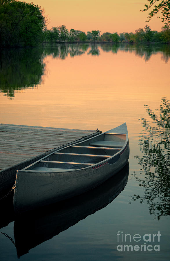 Canoe At A Dock At Sunset Photograph
