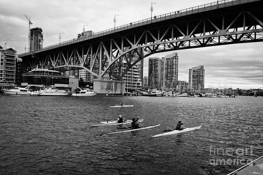 canoeists canoeing along false creek underneath the granville bridge Vancouver BC Canada Photograph  - canoeists canoeing along false creek underneath the granville bridge Vancouver BC Canada Fine Art Print