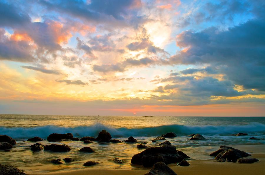 Hawaii Sunset Canoe Hawaiian Sandy Beach Clouds Skyscape Landscape Rocks Sand Waves Ocean Water Sea Sun Color Dream Oahu Nature Motion Creation Blessing Hui  Photograph - Canoes Under The Setting Sun by Joshua Marumoto