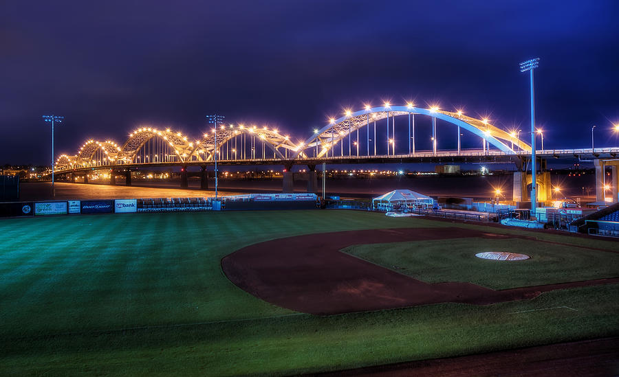 Centennial Bridge And Modern Woodmen Park Photograph