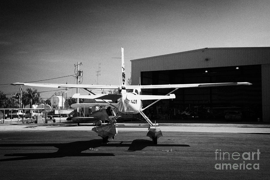 Cessna U206g Fixed Wing Single Engine Seaplane In Front Of Hangar Key West International Airport Flo Photograph  - Cessna U206g Fixed Wing Single Engine Seaplane In Front Of Hangar Key West International Airport Flo Fine Art Print