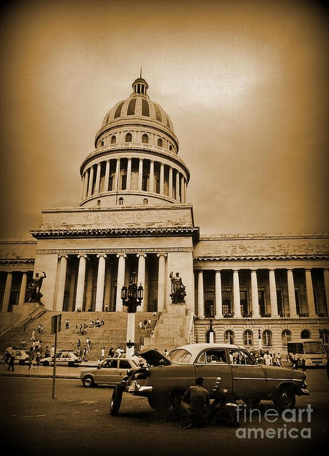 Changing A Tire In Front Of The Capitol Building In Havana Photograph