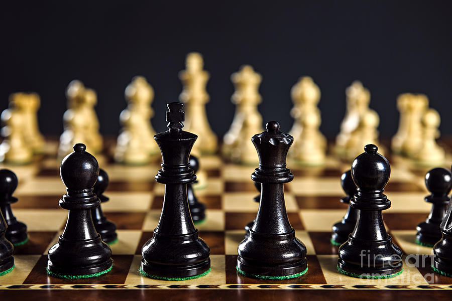 Chess Pieces On Board Photograph