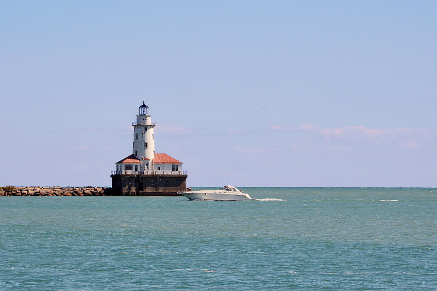 Chicago Light House With Boat In Lake Michigan Photograph