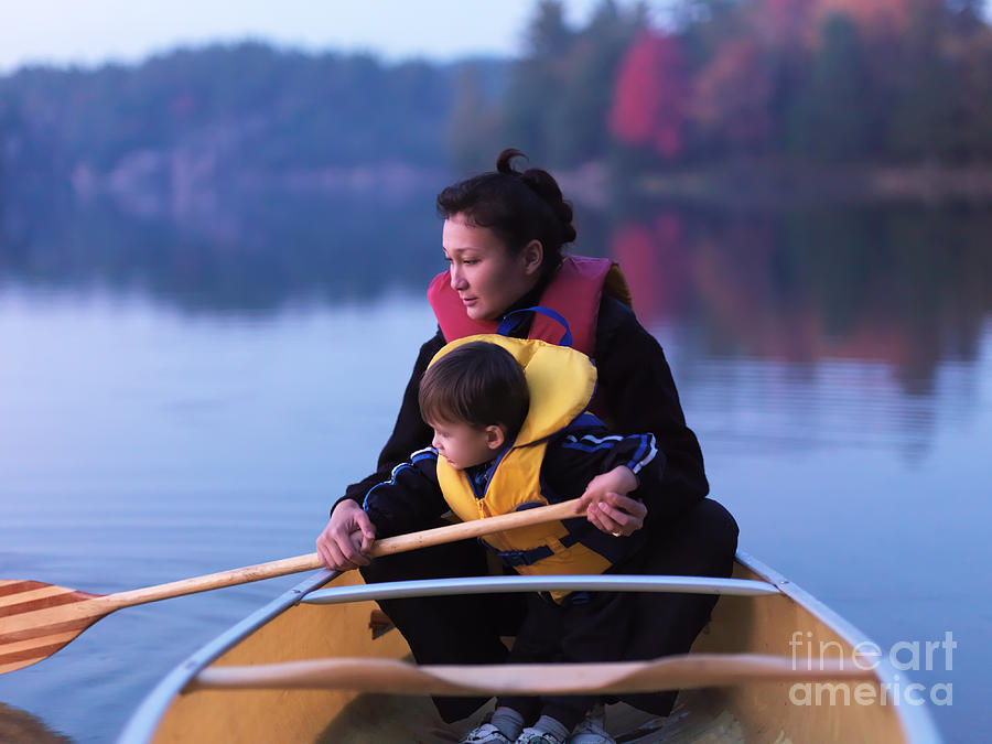 Child Learning To Paddle Canoe Photograph