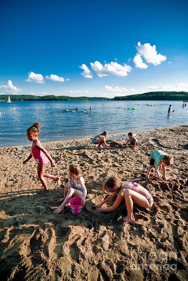Children Playing In The Sand Photograph