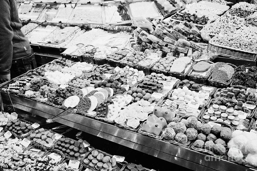 chocolates on display inside the la boqueria market in Barcelona Catalonia Spain Photograph
