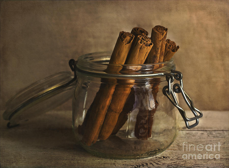 Cinnamon Sticks In A Glass Jar Photograph