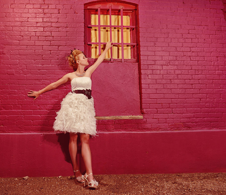 Classy Diva Standing In Front Of Pink Brick Wall  Photograph