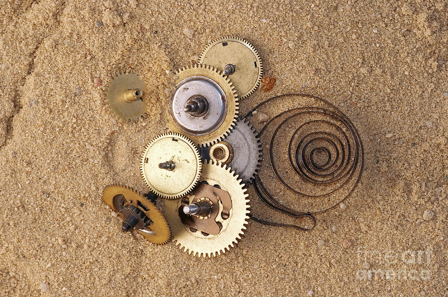 Clockwork Mechanism On The Sand Photograph