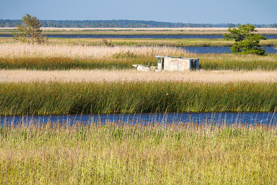 Coastal Landscape Photograph - Coastal Marshlands With Old Fishing Boat by Bill Swindaman