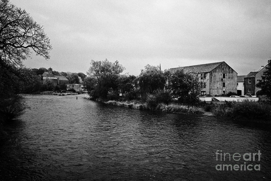 Confluence Of The Rivers Cocker And Derwent On A Rainy Overcast Day Cockermouth Cumbria England Photograph  - Confluence Of The Rivers Cocker And Derwent On A Rainy Overcast Day Cockermouth Cumbria England Fine Art Print