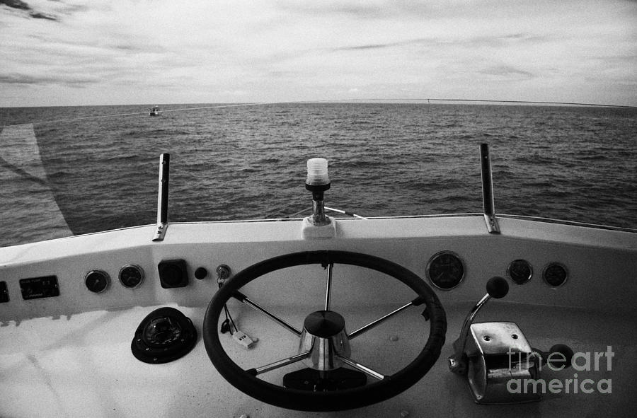 Controls On The Flybridge Deck Of A Charter Fishing Boat In The Gulf Of Mexico Out Photograph