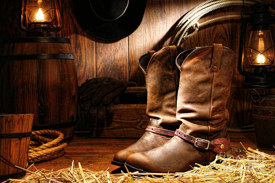 Western Photograph - Cowboy Boots In A Ranch Barn by Olivier Le Queinec