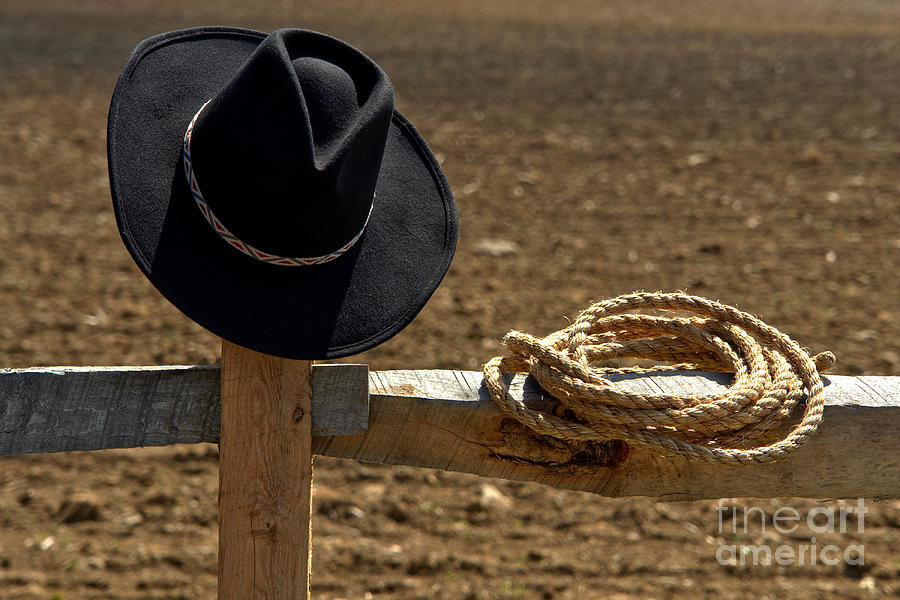 Cowboy Hat And Rope On Fence Photograph