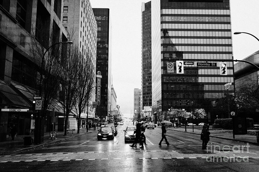 crosswalk at west georgia and hornby downtown in the rain Vancouver BC Canada Photograph