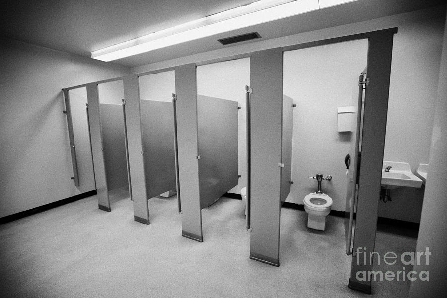 cubicle toilet stalls in womens bathroom in a High school canada north america Photograph