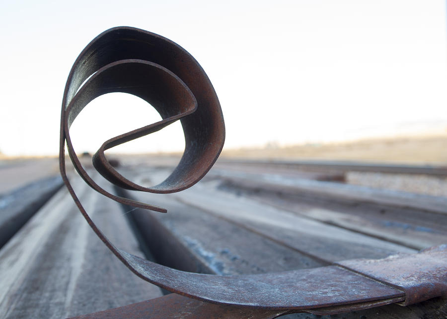 Close-up Photograph - Curled Steel by Fran Riley