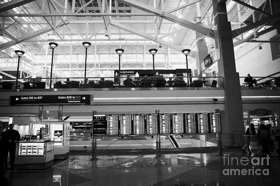 departures board at concourse b Denver International Airport Colorado USA Photograph