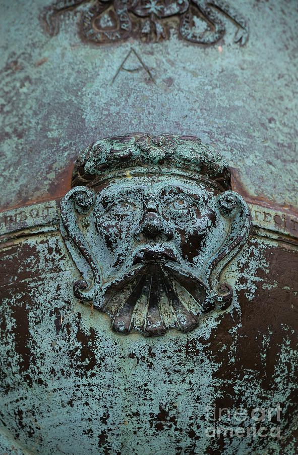 Detail Of A Bronze Mortar Photograph